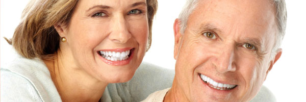 elderly women smilingm, showing off dentures